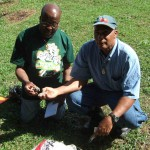 Terry Noel and Cristo Adonis collect clay in Trinidad